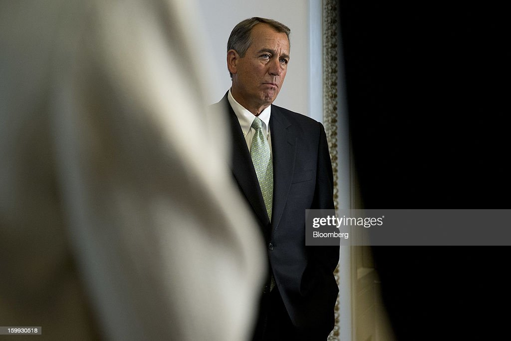 House Speaker <a gi-track='captionPersonalityLinkClicked' href=/galleries/search?phrase=John+Boehner&family=editorial&specificpeople=274752 ng-click='$event.stopPropagation()'>John Boehner</a>, a Republican from Ohio, listens during a news conference following a vote at the U.S. Capitol in Washington, D.C., U.S., on Wednesday, Jan. 23, 2013. The U.S. House voted to temporarily suspend the nation's borrowing limit, removing the debt ceiling for now as a tool for seeking deeper spending cuts. Photographer: Andrew Harrer/Bloomberg via Getty Images