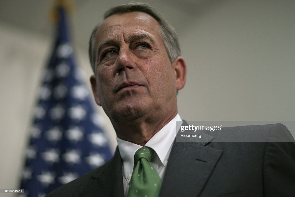House Speaker <a gi-track='captionPersonalityLinkClicked' href=/galleries/search?phrase=John+Boehner&family=editorial&specificpeople=274752 ng-click='$event.stopPropagation()'>John Boehner</a>, a Republican from Ohio, listens during a news conference following a meeting in Washington, D.C., U.S., on Thursday, Sept. 26, 2013. Boehner's choice -- between keeping the government running and continuing to fight the nation's three-year-old health-care law - has implications for the 2014 congressional elections and, potentially, his future. Photographer: Andrew Harrer/Bloomberg via Getty Images