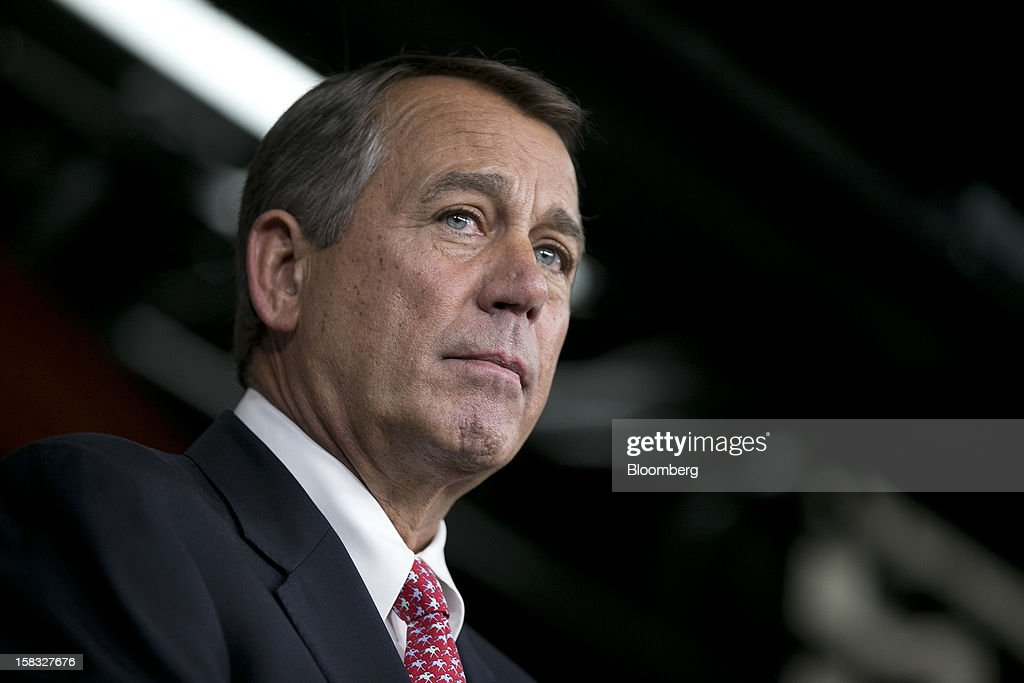 House Speaker <a gi-track='captionPersonalityLinkClicked' href=/galleries/search?phrase=John+Boehner&family=editorial&specificpeople=274752 ng-click='$event.stopPropagation()'>John Boehner</a>, a Republican from Ohio, listens to a question during a news conference in Washington, D.C., U.S., on Thursday, Dec. 13, 2012. Boehner repeated his insistence that President Barack Obama's budget proposal is 'anything but' balanced and accused the president of being 'not serious' about cutting spending. Photographer: Andrew Harrer/Bloomberg via Getty Images