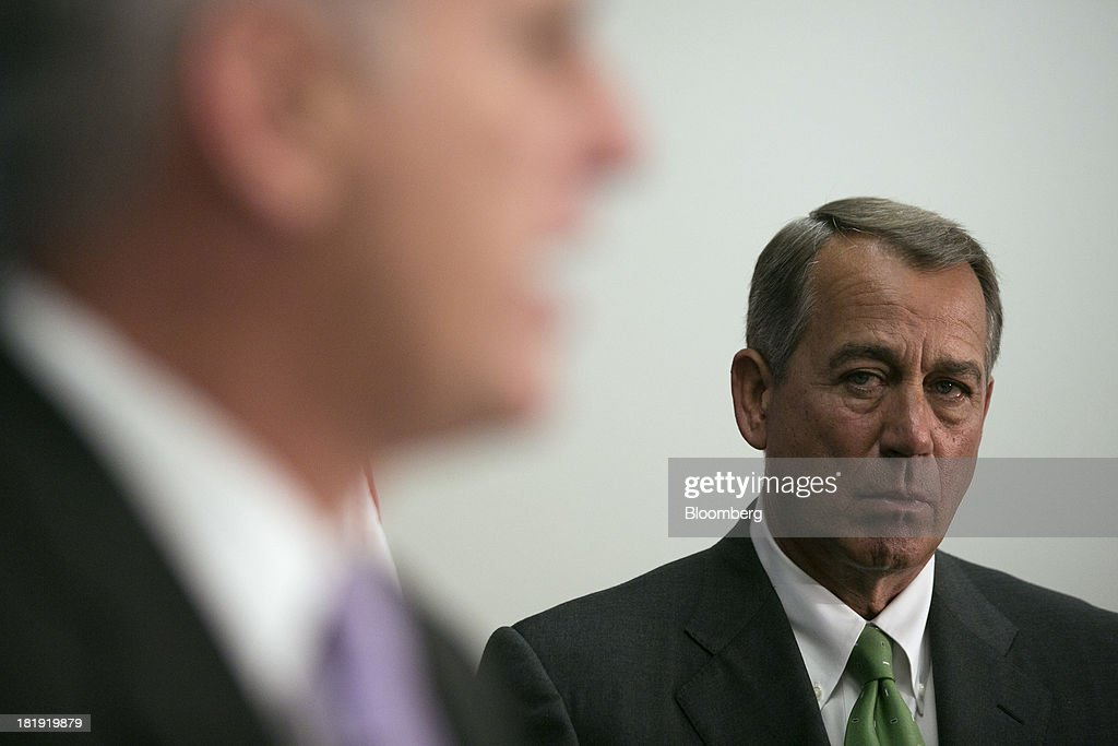 House Speaker <a gi-track='captionPersonalityLinkClicked' href=/galleries/search?phrase=John+Boehner&family=editorial&specificpeople=274752 ng-click='$event.stopPropagation()'>John Boehner</a>, a Republican from Ohio, right, looks on as Majority Whip Kevin McCarthy, a Republican from California, speaks during a news conference following a meeting in Washington, D.C., U.S., on Thursday, Sept. 26, 2013. Boehner's choice -- between keeping the government running and continuing to fight the nation's three-year-old health-care law - has implications for the 2014 congressional elections and, potentially, his future. Photographer: Andrew Harrer/Bloomberg via Getty Images