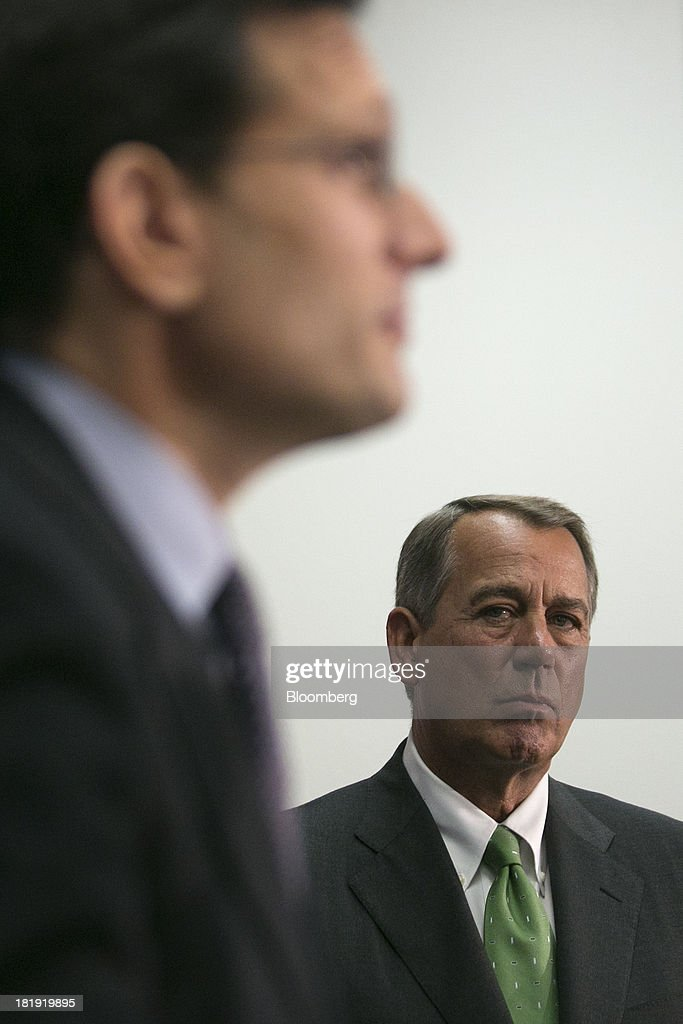 House Speaker <a gi-track='captionPersonalityLinkClicked' href=/galleries/search?phrase=John+Boehner&family=editorial&specificpeople=274752 ng-click='$event.stopPropagation()'>John Boehner</a>, a Republican from Ohio, right, looks on as House Majority Leader <a gi-track='captionPersonalityLinkClicked' href=/galleries/search?phrase=Eric+Cantor&family=editorial&specificpeople=653711 ng-click='$event.stopPropagation()'>Eric Cantor</a>, a Republican from Virginia, speaks during a news conference following a meeting in Washington, D.C., U.S., on Thursday, Sept. 26, 2013. Boehner's choice -- between keeping the government running and continuing to fight the nation's three-year-old health-care law - has implications for the 2014 congressional elections and, potentially, his future. Photographer: Andrew Harrer/Bloomberg via Getty Images