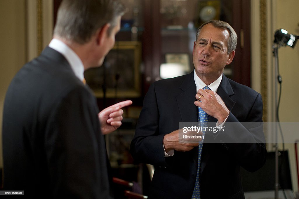 House Speaker <a gi-track='captionPersonalityLinkClicked' href=/galleries/search?phrase=John+Boehner&family=editorial&specificpeople=274752 ng-click='$event.stopPropagation()'>John Boehner</a>, a Republican from Ohio, right, talks to Bloomberg Television reporter Peter Cook following an interview at the U.S. Capitol in Washington, D.C., U.S., on Tuesday, May 7, 2013. Boehner said he probably won't support legislation to let states require out-of-state Internet retailers to collect sales taxes, saying it would be too cumbersome to implement. Photographer: Andrew Harrer/Bloomberg via Getty Images