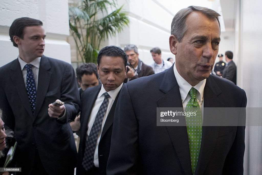 House Speaker John Boehner, a Republican from Ohio, right, walks out of a House Republican caucus meeting at the U.S. Capitol in Washington, D.C., U.S., on Tuesday, Jan. 1, 2013. The U.S. Senate passed a bipartisan budget deal two hours after income tax cuts expired, reaching an after-deadline agreement to undo the potential economic harm of $600 billion in tax increases and spending cuts. Photographer: Andrew Harrer/Bloomberg via Getty Images