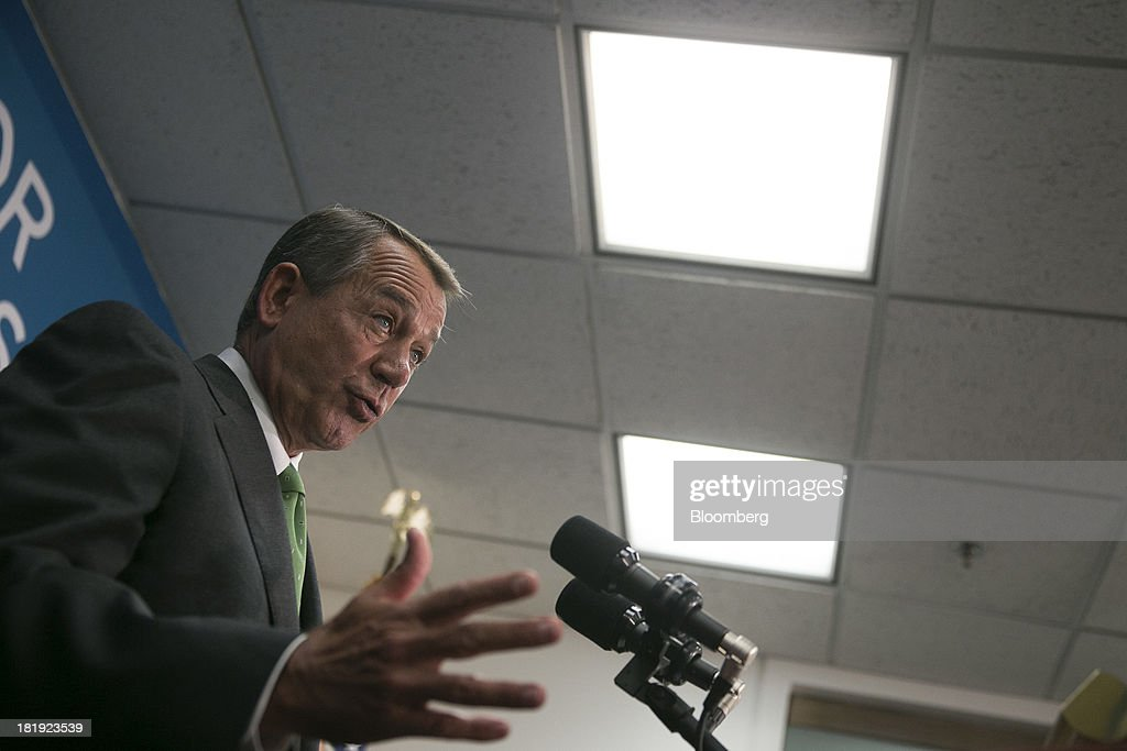 House Speaker <a gi-track='captionPersonalityLinkClicked' href=/galleries/search?phrase=John+Boehner&family=editorial&specificpeople=274752 ng-click='$event.stopPropagation()'>John Boehner</a>, a Republican from Ohio, speaks during a news conference following a meeting in Washington, D.C., U.S., on Thursday, Sept. 26, 2013. Boehner's choice -- between keeping the government running and continuing to fight the nation's three-year-old health-care law - has implications for the 2014 congressional elections and, potentially, his future. Photographer: Andrew Harrer/Bloomberg via Getty Images