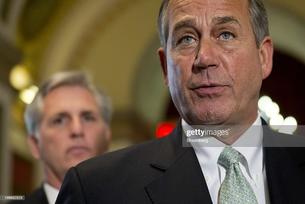 House Speaker <a gi-track='captionPersonalityLinkClicked' href=/galleries/search?phrase=John+Boehner&family=editorial&specificpeople=274752 ng-click='$event.stopPropagation()'>John Boehner</a>, a Republican from Ohio, speaks following a vote with House Majority Whip Kevin McCarthy, a Republican from California, left, at the U.S. Capitol in Washington, D.C., U.S., on Wednesday, Jan. 23, 2013. The U.S. House voted to temporarily suspend the nation's borrowing limit, removing the debt ceiling for now as a tool for seeking deeper spending cuts. Photographer: Andrew Harrer/Bloomberg via Getty Images