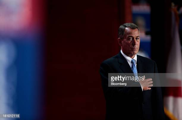 House Speaker John Boehner a Republican from Ohio stands during the pledge of allegiance at the Republican National Convention in Tampa Florida US on...