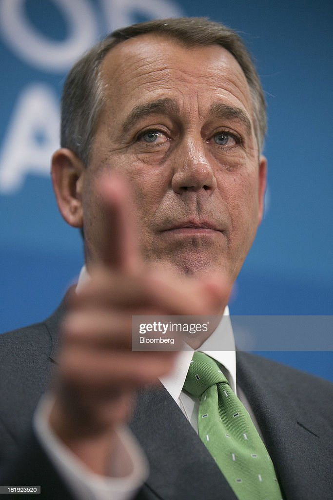 House Speaker <a gi-track='captionPersonalityLinkClicked' href=/galleries/search?phrase=John+Boehner&family=editorial&specificpeople=274752 ng-click='$event.stopPropagation()'>John Boehner</a>, a Republican from Ohio, takes a reporter's question during a news conference following a meeting in Washington, D.C., U.S., on Thursday, Sept. 26, 2013. Boehner's choice -- between keeping the government running and continuing to fight the nation's three-year-old health-care law - has implications for the 2014 congressional elections and, potentially, his future. Photographer: Andrew Harrer/Bloomberg via Getty Images