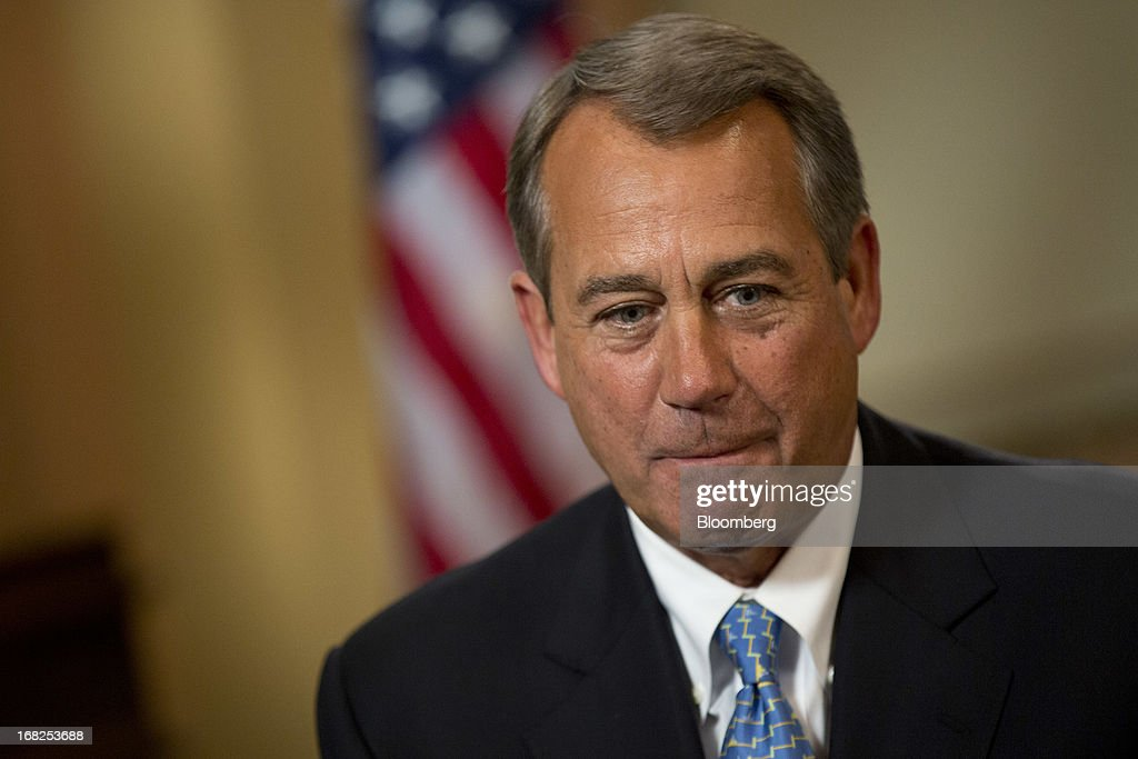 House Speaker <a gi-track='captionPersonalityLinkClicked' href=/galleries/search?phrase=John+Boehner&family=editorial&specificpeople=274752 ng-click='$event.stopPropagation()'>John Boehner</a>, a Republican from Ohio, talks prior to an interview at the U.S. Capitol in Washington, D.C., U.S., on Tuesday, May 7, 2013. Boehner said he probably won't support legislation to let states require out-of-state Internet retailers to collect sales taxes, saying it would be too cumbersome to implement. Photographer: Andrew Harrer/Bloomberg via Getty Images