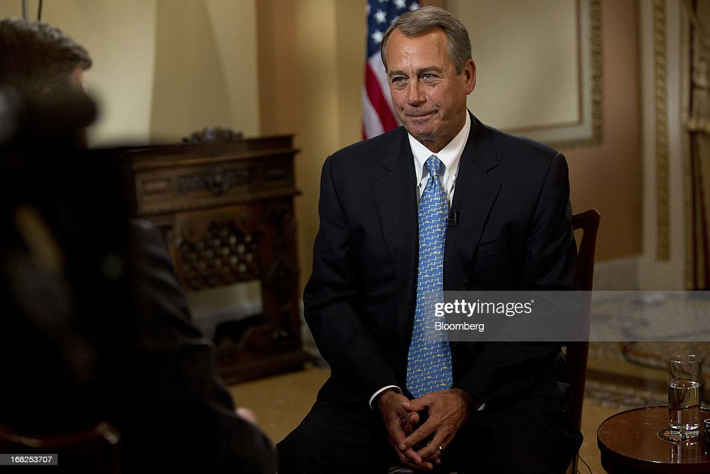 House Speaker John Boehner, a Republican from Ohio, talks to Bloomberg Television reporter Peter Cook, left, prior to an interview at the U.S. Capitol in Washington, D.C., U.S., on Tuesday, May 7, 2013. Boehner said he probably won't support legislation to let states require out-of-state Internet retailers to collect sales taxes, saying it would be too cumbersome to implement. Photographer: Andrew Harrer/Bloomberg via Getty Images