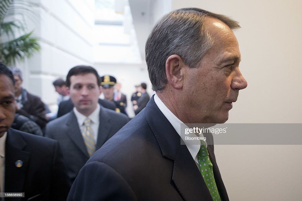 House Speaker <a gi-track='captionPersonalityLinkClicked' href=/galleries/search?phrase=John+Boehner&family=editorial&specificpeople=274752 ng-click='$event.stopPropagation()'>John Boehner</a>, a Republican from Ohio, walks out of a House Republican caucus meeting at the U.S. Capitol in Washington, D.C., U.S., on Tuesday, Jan. 1, 2013. The U.S. Senate passed a bipartisan budget deal two hours after income tax cuts expired, reaching an after-deadline agreement to undo the potential economic harm of $600 billion in tax increases and spending cuts. Photographer: Andrew Harrer/Bloomberg via Getty Images