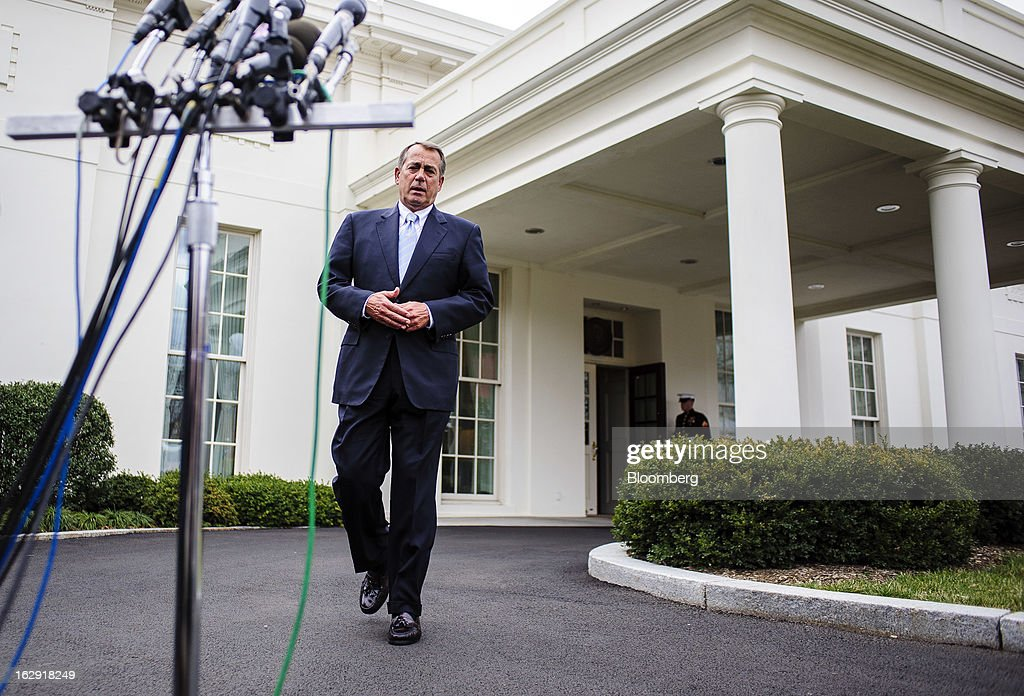 House Speaker John Boehner, a Republican from Ohio, walks toward a bank of microphones as he prepares to speak to the media outside the West Wing of the White House following a meeting with President Barack Obama and congressional leaders in Washington, D.C., U.S., on Friday, March 1, 2013. Boehner said the House will vote next week on legislation to fund the government for the rest of the fiscal year so Congress won't have to deal with the risk of a government shutdown while negotiating an agreement on cutting the deficit. Photographer: Pete Marovich/Bloomberg via Getty Images