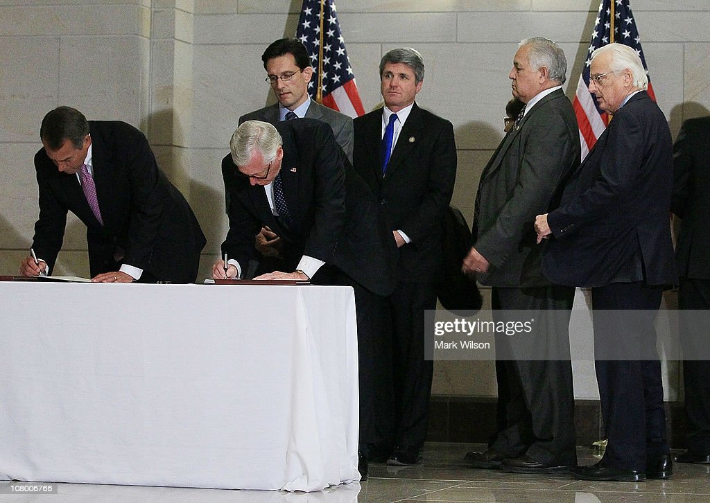House Speaker John Boehner and House Minority Whip US Rep Steny Hoyer sign a condolence and well wishes book for the victims of the mass shooting in...
