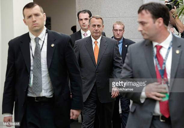 House Speaker John Boehner arrives for a meeting of House Republicans on the proposed Senate debt limit and government shutdown deal October 16 2013...