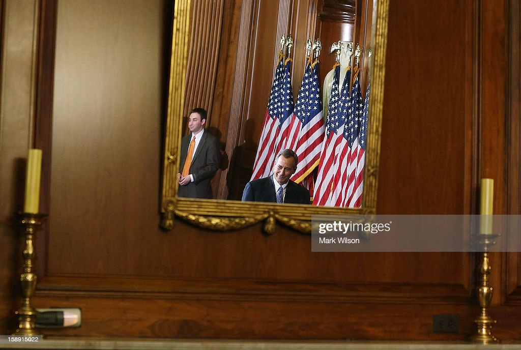 House Speaker John Boehner (R-OH) is reflected in a mirror while participating in swearing in re-enactments, on January 3, 2013 in Washington, DC. Earlier in the day House Speaker Boehner presided over the swearing in of the newly elected members of the 113th Congress.