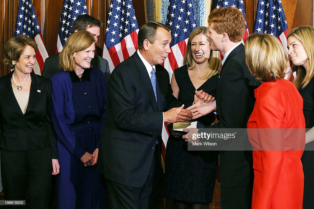 House Speaker <a gi-track='captionPersonalityLinkClicked' href=/galleries/search?phrase=John+Boehner&family=editorial&specificpeople=274752 ng-click='$event.stopPropagation()'>John Boehner</a> (R-OH) (4th L), jokes with U.S. Rep. Joseph Kennedy (D-MA) (3rd R) during a re-enactment ceremony after the first session of the 113th Congress convened, on January 3, 2013 in Washington, DC. Also present are family members of Rep. Kennedy.