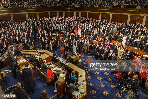 House Speaker John Boehner left administers the oath to House members on opening day of the 114th Congress on January 2015 in Washington DC