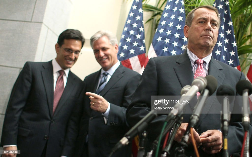 House Speaker John Boehner listens to questions from reporters as House Majority Leader Eric Cantor and House Majority Whip Kevin McCarthy look on...