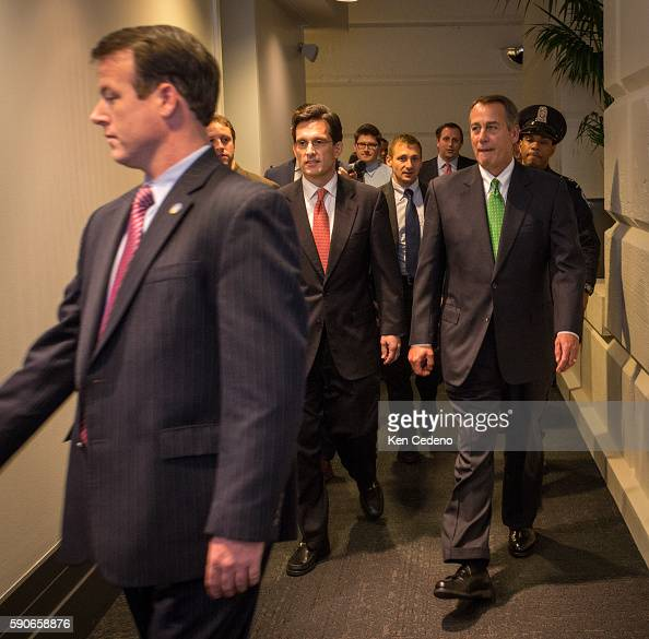 House Speaker John Boehner right and House Majority Leader from Eric Cantor center walk into a Republican caucus meeting to consider the terms of the...