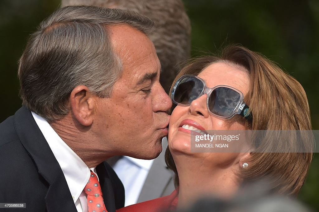 House Speaker <a gi-track='captionPersonalityLinkClicked' href=/galleries/search?phrase=John+Boehner&family=editorial&specificpeople=274752 ng-click='$event.stopPropagation()'>John Boehner</a> (L), R-OH, kisses House Minority Leader <a gi-track='captionPersonalityLinkClicked' href=/galleries/search?phrase=Nancy+Pelosi&family=editorial&specificpeople=169883 ng-click='$event.stopPropagation()'>Nancy Pelosi</a>, D-CA, during a reception for supporters of H.R. 2, the Medicare Access and CHIP Reauthorization Act of 2015, in the Rose Garden of the White House on April 21, 2015 in Washington, DC. AFP PHOTO/MANDEL NGAN