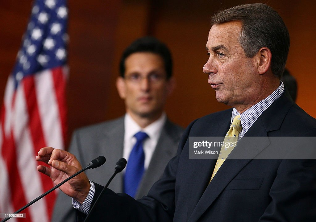 House Speaker John Boehner speaks while flanked by House Majority Leader Eric Cantor during a news conference at the US Capitol July 22 2011 in...