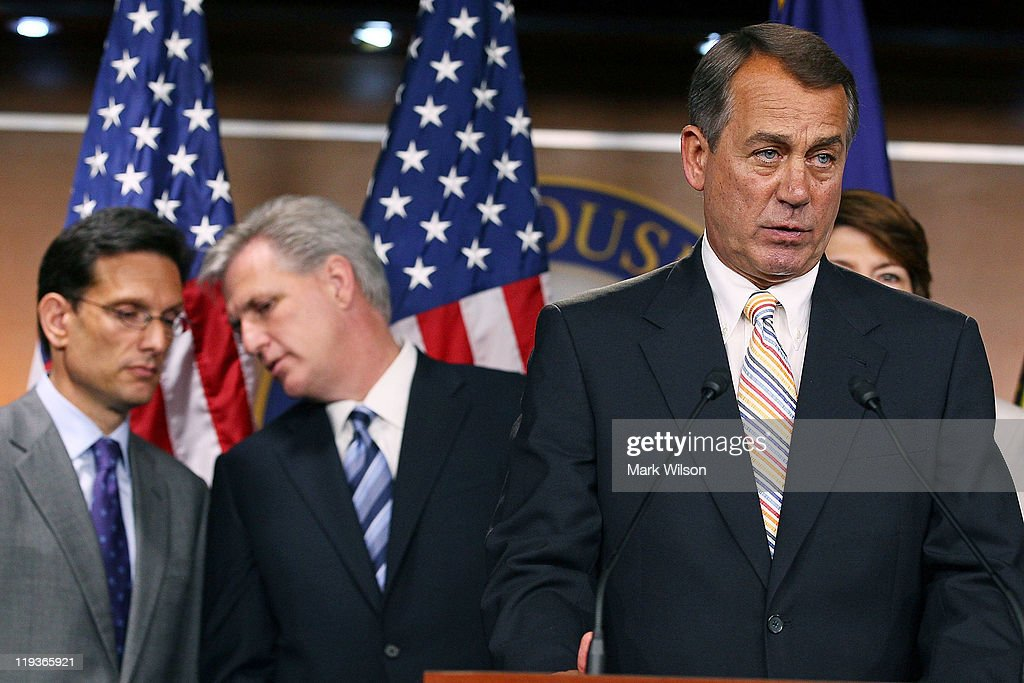 House Speaker John Boehner speaks while Majority Leader Eric Cantor and Majority Whip Kevin McCarthy stand behind him during a news conference at the...