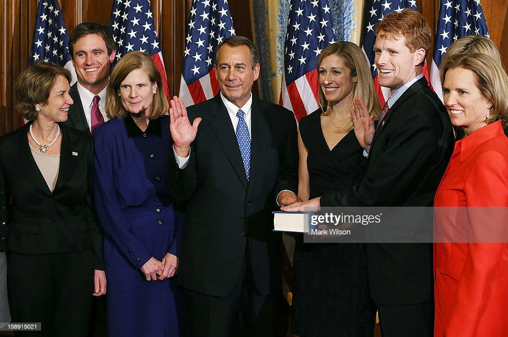 House Speaker <a gi-track='captionPersonalityLinkClicked' href=/galleries/search?phrase=John+Boehner&family=editorial&specificpeople=274752 ng-click='$event.stopPropagation()'>John Boehner</a> (R-OH) (3rd L) swears in U.S. Rep. Joseph Kennedy (D-MA) (2nd R) as his fiance Lauren Ann Birchfield (3rd R) holds a bible during a re-enactment ceremony after the first session of the 113th Congress convened, on January 3, 2013 in Washington, DC. Also present are family members of Rep. Kennedy.