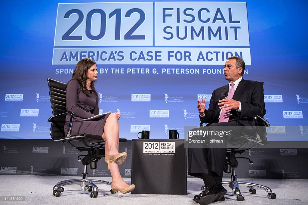 House Speaker John Boehner (R-OH) talks with moderator <a gi-track='captionPersonalityLinkClicked' href=/galleries/search?phrase=Erin+Burnett&family=editorial&specificpeople=4401523 ng-click='$event.stopPropagation()'>Erin Burnett</a> (L) at the 2012 Fiscal Summit on May 15, 2012 in Washington, DC. The third annual summit, held by the Peter G. Peterson Foundation, explored the theme 'America's Case for Action.'