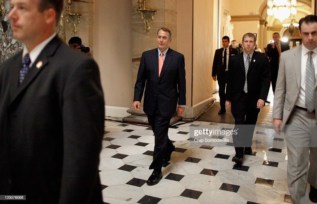 House Speaker John Boehner walks back to his office while the House of Representatives votes on the Budget Control Act at the US Capitol July 29 2011...