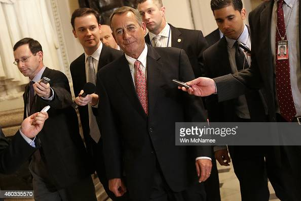 House Speaker John Boehner walks to the House chamber for an expected vote on a $11 trillion government funding bill on December 11 2014 in...