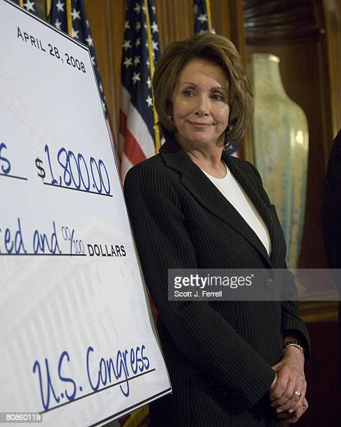 House Speaker Nancy Pelosi DCalif stands next to a tax rebate check mockup during a news conference on tax rebates As congressional Democrats debate...