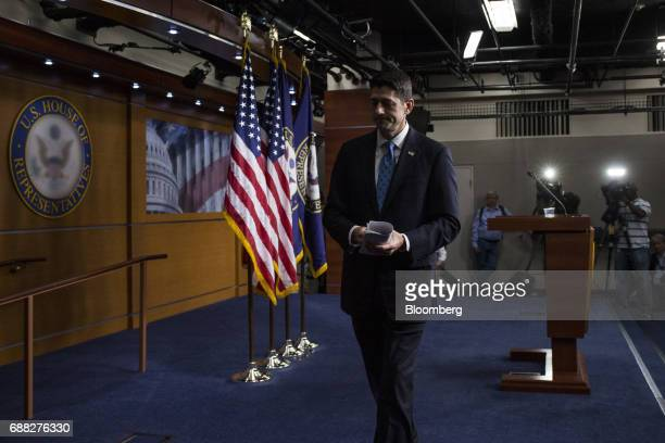 US House Speaker Paul Ryan a Republican from Wisconsin exits after speaking during a news conference on Capitol Hill in Washington DC US on Thursday...