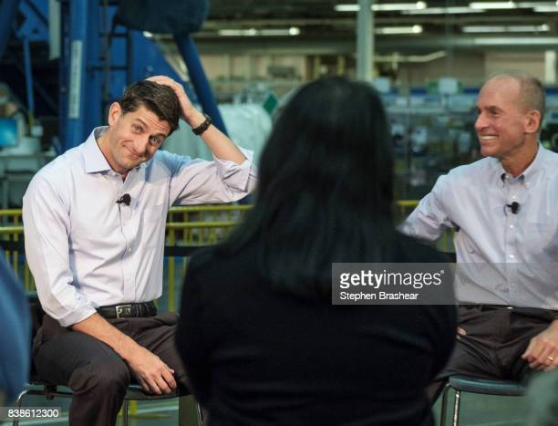 House Speaker Paul Ryan reacts to an audience member's question during a town hall with Boeing Company CEO Dennis Muilenburg and Boeing employees at...