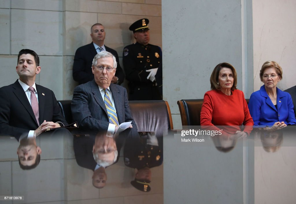 House Speaker Paul Ryan (R-WI), Senate Majority Leader Mitch McConnell (R-KY), House Minority Leader Nancy Pelosi (D-CA), Sen. Elizabeth Warren (D-MA), participate in a ceremony to honor American prisoners of war and the nearly 83,000 servicemen and women missing in action, at the US Capitol on November 8, 2017 in Washington, DC.