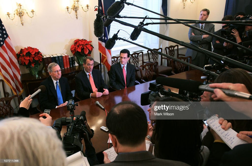 House Speakerdesignate John Boehner is flanked by Senate Republican Leader Mitch McConnell and House Majority Leaderelect Eric Cantor while...