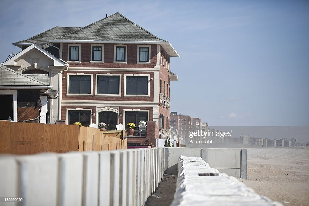 A house stands next to a reinforced concrete wall and large sand bags on October 26, 2013 in the Queens borough of New York City. Hurricane Sandy made landfall on October 29, 2012 near Brigantine, New Jersey and affected 24 states from Florida to Maine and cost the country an estimated $65 billion.