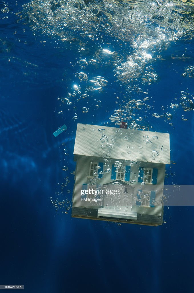 House under water : Stock Photo