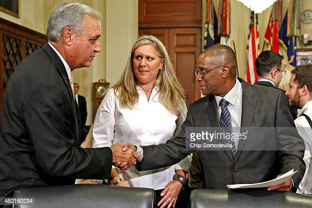 House Veterans Affairs Committee Chairman Jeff Miller greets the Department of Veterans Affairs employee Kristen Ruell and Veterans Benefits Service...