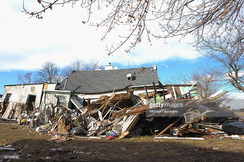 A house victimized by Superstorm Sandy a month prior remains devastated on December 5, 2012 in Union Beach, New Jersey. With a population of 6,200, roughly 1,000 homes were flooded and 200 rendered inhabitable.