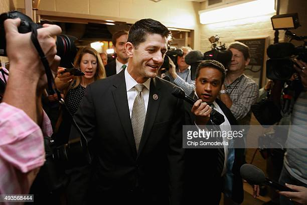 House Ways and Means Committee Chairman Paul Ryan arrives for a House Republican caucus meeting in the US Capitol on October 21 2015 in Washington DC...