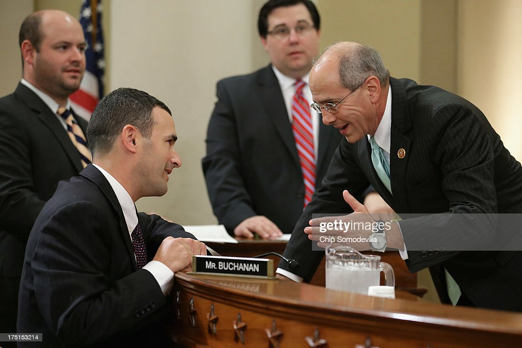 House Ways and Means Committee member U.S. Rep. Charles Boustany (R-LA) (R) talks with Internal Revenue Service Principal Deputy Commissioner and Deputy Commissioner for Services and Enforcement Daniel Werfel before a hearing in the Longworth House Office Building on Capitol Hill August 1, 2013 in Washington, DC. During a hearing titled, 'The Status of the Affordable Care Act Implementation,' the committee questioned representatives from the Centers for Medicare and Medicaid Services and the Internal Revenue Service responsible for implimenting the ACA.