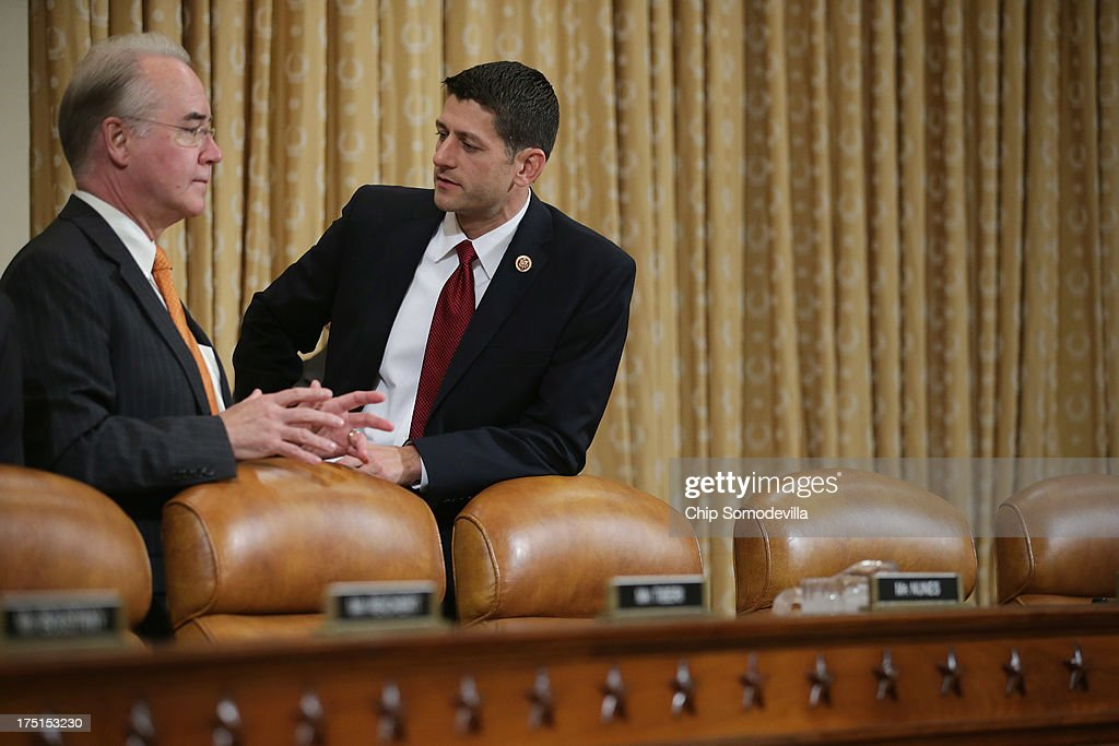 House Ways and Means Committee members U.S. Rep. Paul Ryan (R-WI) (R) and U.S. Rep. <a gi-track='captionPersonalityLinkClicked' href=/galleries/search?phrase=Tom+Price&family=editorial&specificpeople=653710 ng-click='$event.stopPropagation()'>Tom Price</a> (R-GA) visit before a committee hearing in the Longworth House Office Building on Capitol Hill August 1, 2013 in Washington, DC. During a hearing titled, 'The Status of the Affordable Care Act Implementation,' the committee questioned representatives from the Centers for Medicare and Medicaid Services and the Internal Revenue Service responsible for implimenting the ACA.