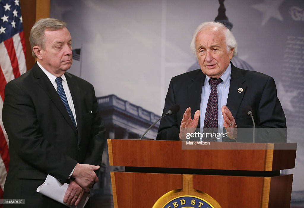House Ways and Means ranking member U.S. Rep. Sander Levin, (D-MI) (R) speaks while Senate Assistant Minority Leader <a gi-track='captionPersonalityLinkClicked' href=/galleries/search?phrase=Dick+Durbin&family=editorial&specificpeople=208219 ng-click='$event.stopPropagation()'>Dick Durbin</a>, (D-IL) listens during a news conference to announce new legislation on Capitol Hill, January 20, 2015 in Washington, DC. The Democratic lawmakers held the news conference to announce legislation to tighten restrictions on corporate tax inversions, making it more difficult for American companies to lower their U.S. taxation by combining with a smaller foreign business and moving their tax address overseas.