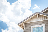 House Window and Roof with Clouds in the Sky