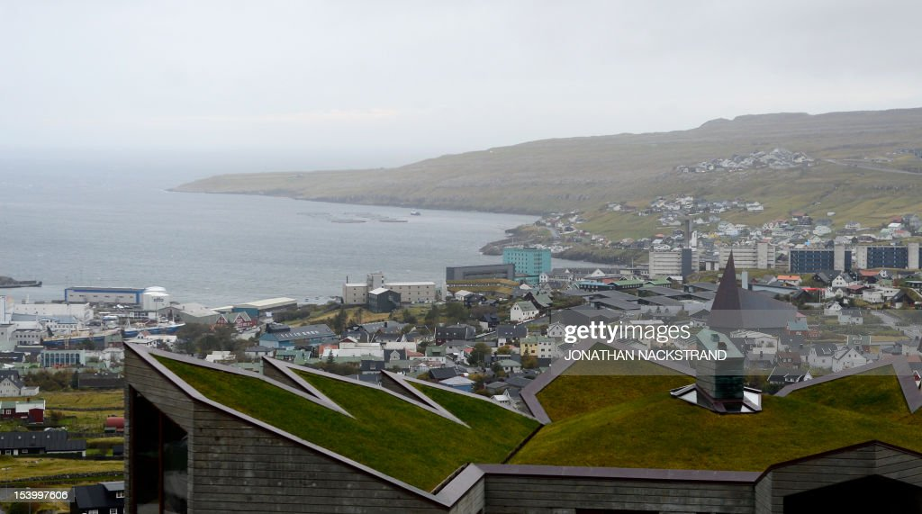 A house with a green roof in Torshavn on October 12, 2012 on the Streymoy Island, the largest of Faroe Islands in this Atlantic ocean archipelago nation. The Faroe Islands are known for its fishing and sheep farming as the main industries.
