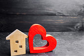 """House with a red heart. House of lovers. Affordable housing for young families. Valentine's day house. """"Home Sweet Home"""". life insurance"""