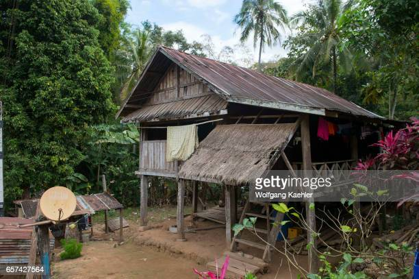 A house with a satellite dish in Ban Muangkeo Village a cultural heritage village on the Mekong River near Luang Prabang in Central Laos