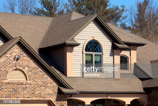 House With Brick Vinyl Siding Halfround Windows Stucco