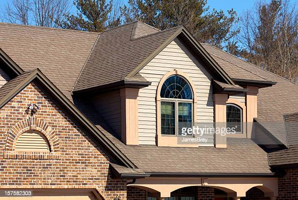 House With Brick, Vinyl Siding, Half-Round Windows, Stucco Accents