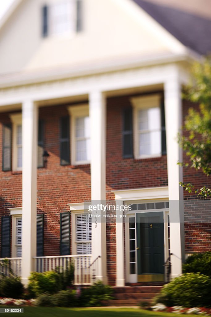 House with columns in front : Stock Photo