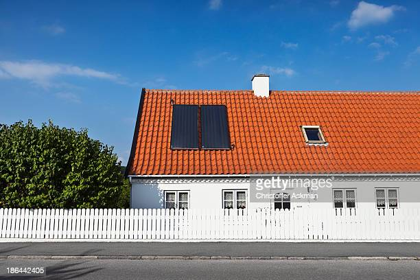House with solar heating panels